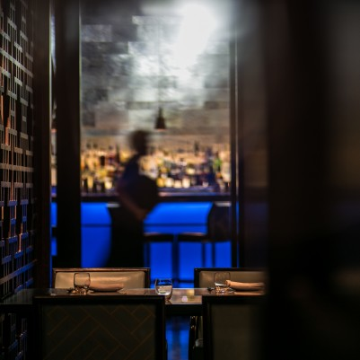 Hakkasan's main dining room interiors surrounded by latticework and cool blue accents.